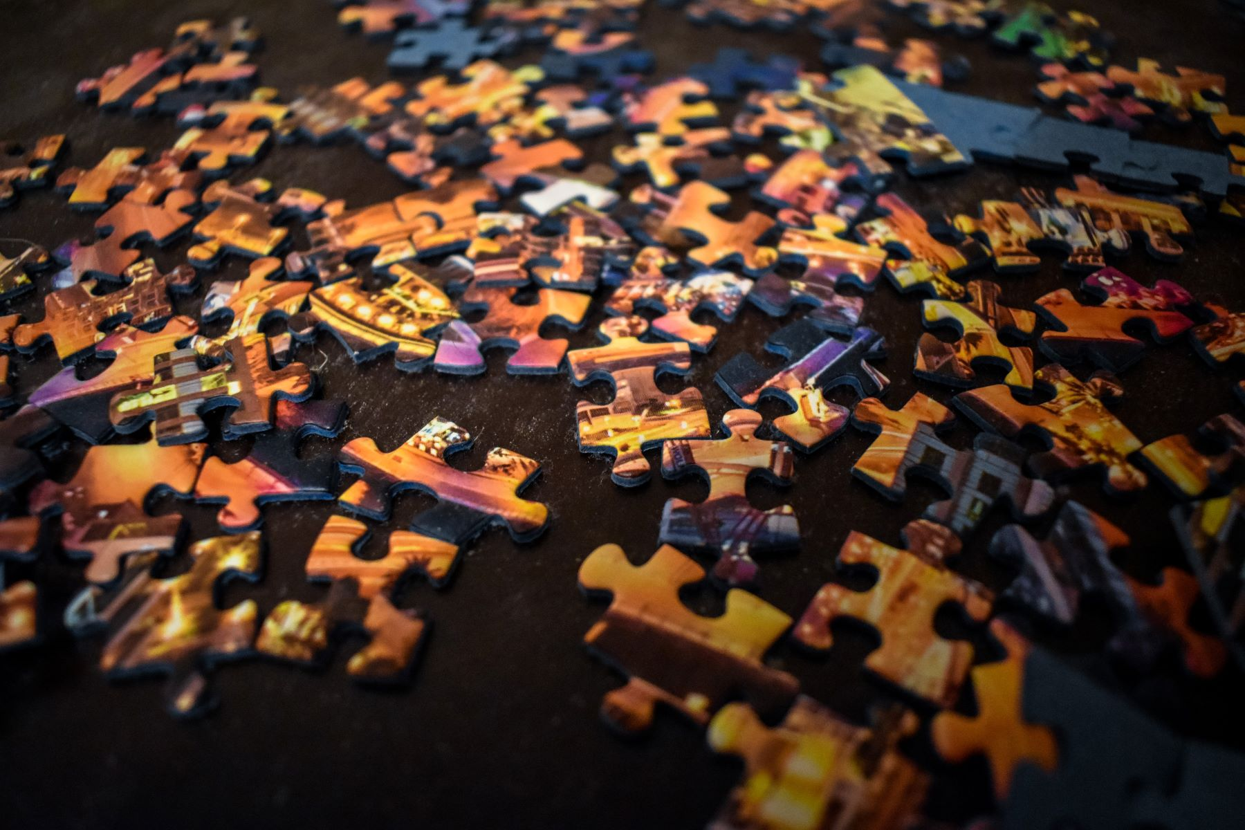 Image of jigsaw pieces waiting to be put together, to represent sales teams working together.