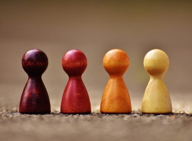 Image of wooden peg dolls to represent people that you may wish to target through account based marketing