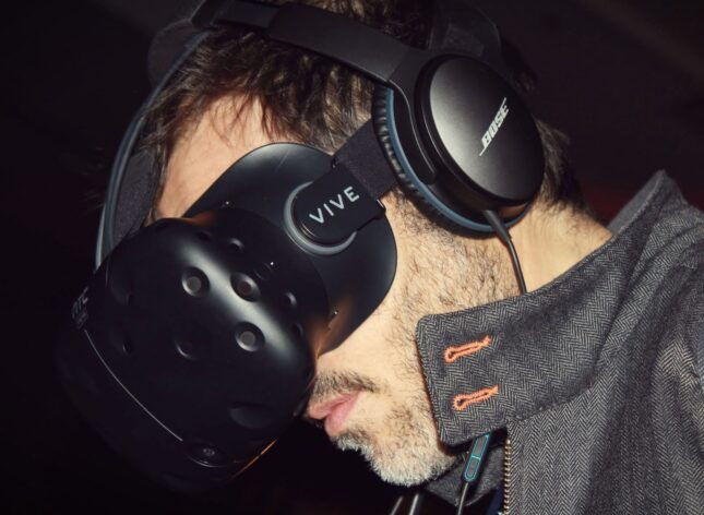 An image of a man wearing a VR headset