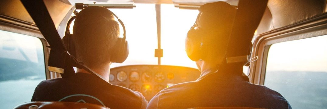 Image of pilots in a cockpit to depict Outsourced Engagement's vision of helping companies soar to success