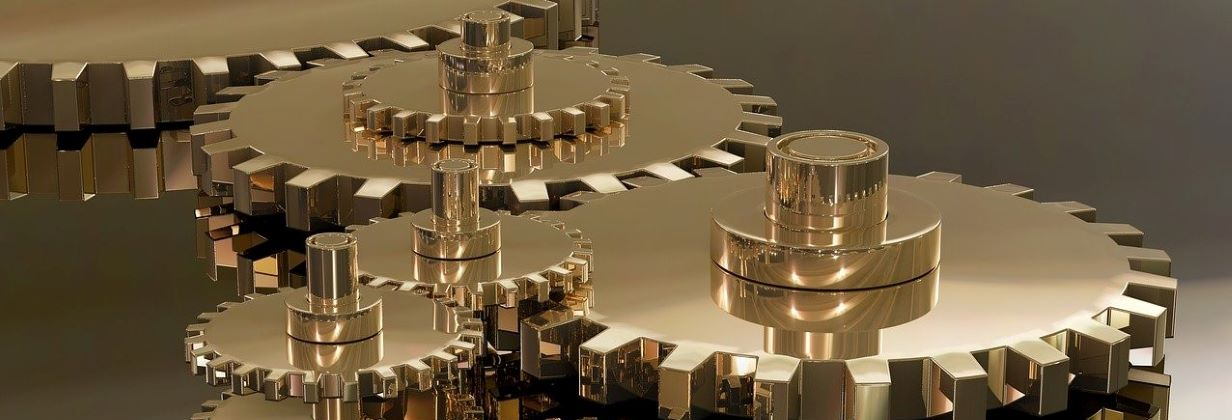 Close up image of a cogs turning to demonstrate how the team at Outsourced Engagement work closely together with their clients