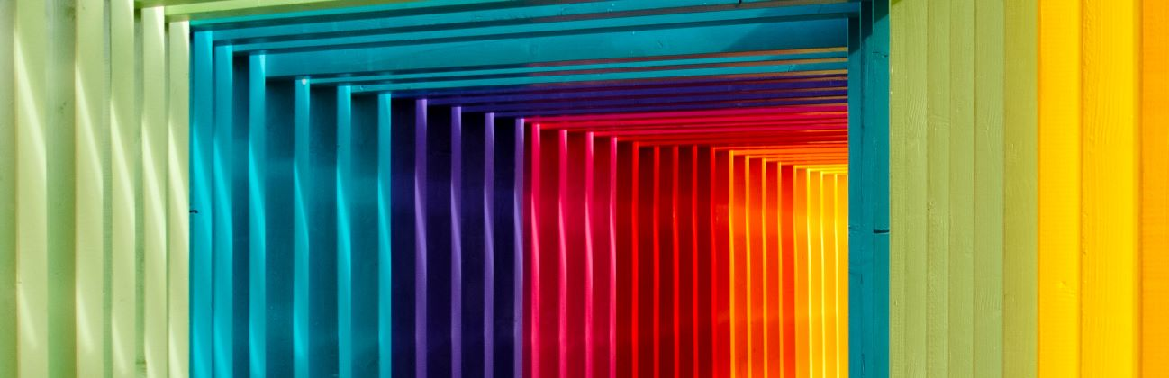 Rainbow coloured slats to indicate the range of Outsourced Engagement's range of services