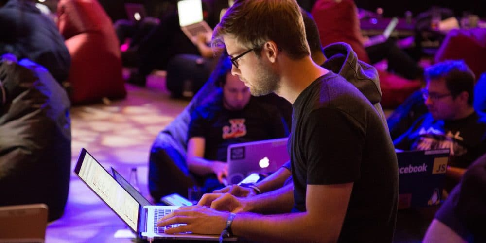 Image of a person in a laptop to depict the technology sector